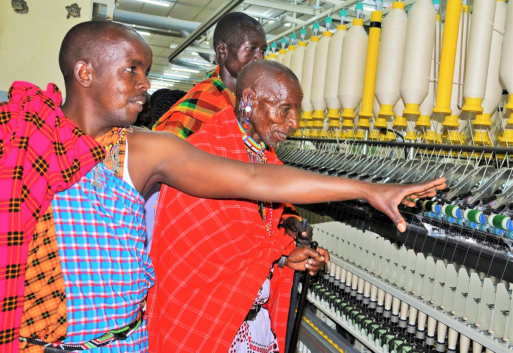Elders from Naikarra self help group in Narok county marvel at the modernized machines during a visit to our textile facility
